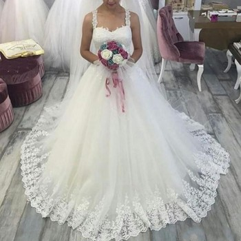 ZH4218G Casual Beach A Line Wedding Dresses 2019 Spaghetti Straps Lace Appliqued Court Train Empire Waist Elegant Bridal Gowns