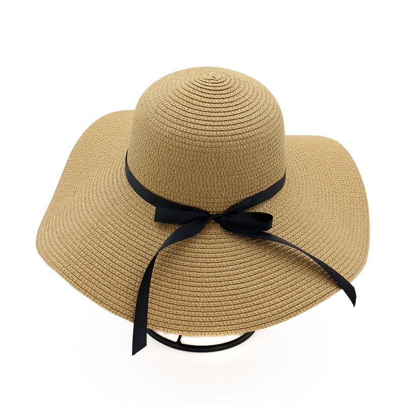 c775f76f De las mujeres de ala sombrero de sol disquete plegable Bowknot sombrero de  paja de verano