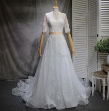 NW1274 V-neckline Sheer Lace Middle Long Sleeves Delicately Guipure Lace Decoraton Bridal Dress A-line Skirt with Champange Belt