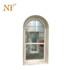White aluminum single hung arched window with grill