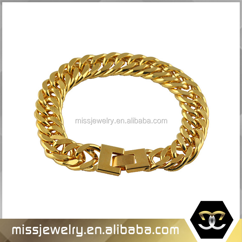 solid gold woven bracelet in hand yellow and large