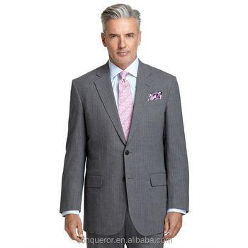 light grey suit. Full canvas construction. Center vent. Pleat ...