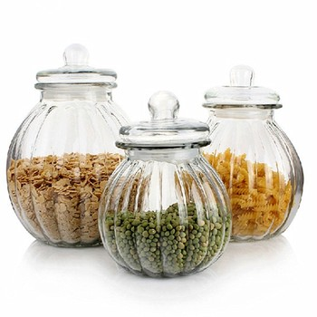 Factory price kitchen storage clear pumpkin shaped glass jars with sealed glass lids wholesale