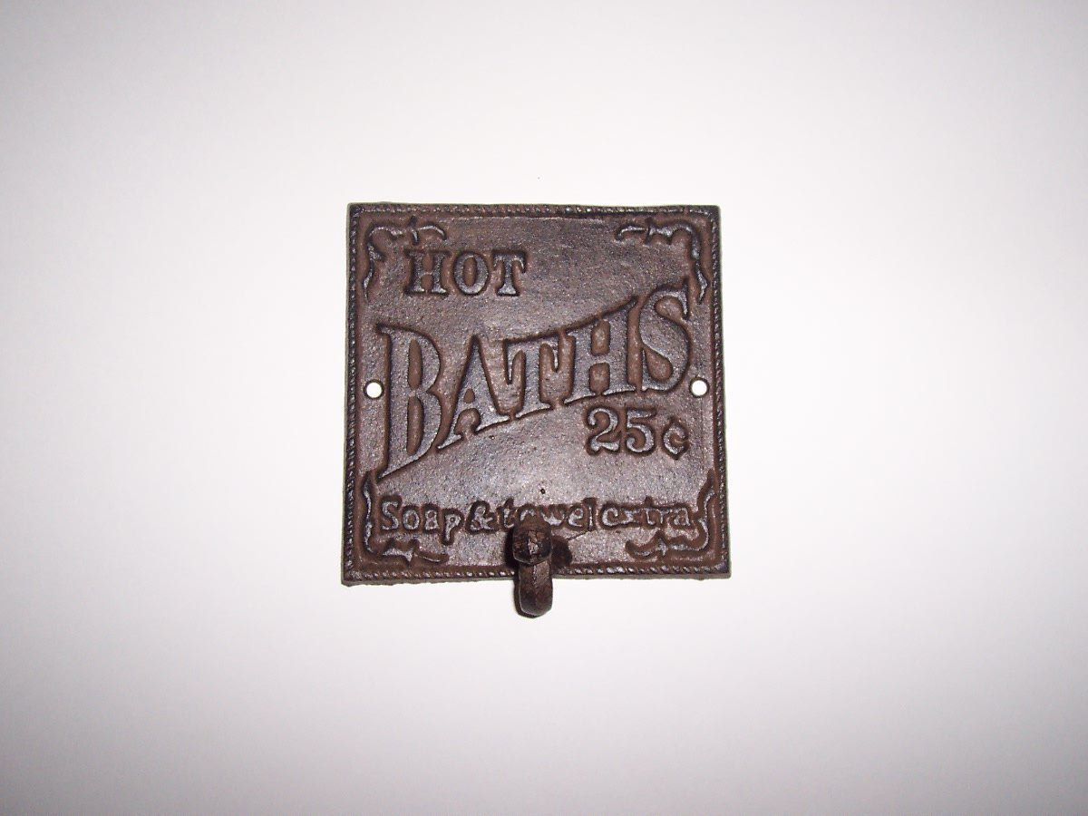 """ABC Products"" - Heavy Cast Iron - All-Purpose Bath Plaque - With Large Hook - 5-1/2 Inch Square - With The Words ""Hot Baths 25 Cents Soap and Towel Extra"" - (Bronze Rustic Finish - Wall Mount )"