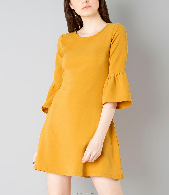 mosterdgeel jurk
