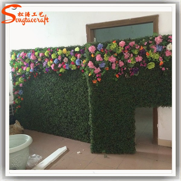 grass and flower made of artificial green wall for garden and office