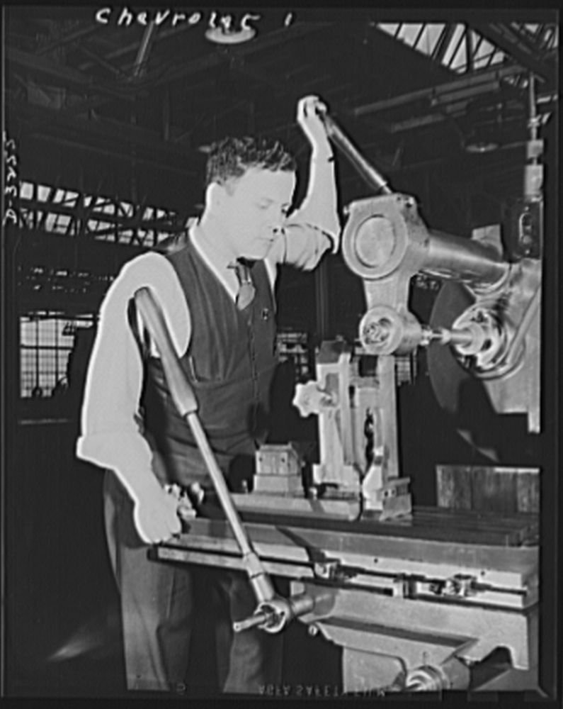 1942 Photo Auto conversion to airplane engines. With normal operations of this automobile factory suspended for the duration, the gigantic task of converting the entire plant to war production was tak