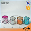 Colored decorative glass candle holder with metal handle