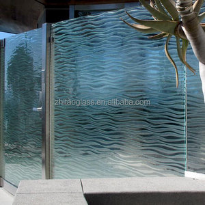 Tempered wave patterned cast glass building wall