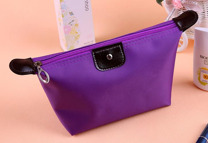 Wholesale fashion new style cheaper price online shopping toiletry dumpling cosmetic bags women