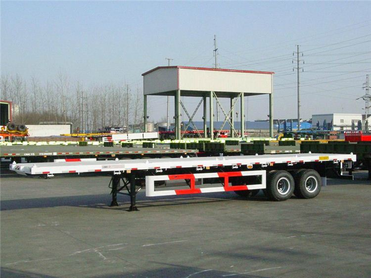 China 12.5m tri axle flatbed container semi trailer with 6x4 sino truck head