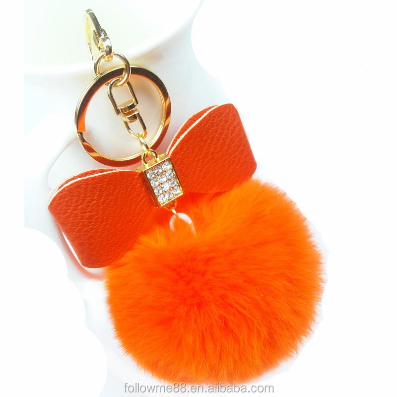 8cm Lovely Fluffy Fur Ball Keyrings Bow-knot Pompom Artificial Rabbit Fur  Keychain solid Color Women Car Handbag Key Ring c4bdb0abfd