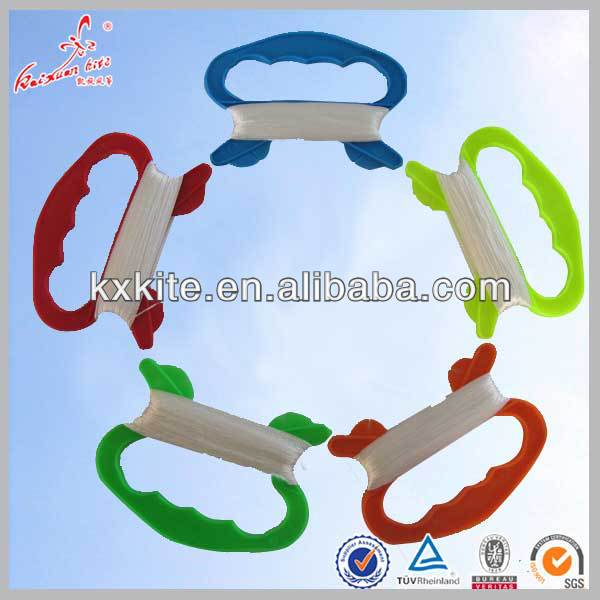 Kite flying thread with plastic handle