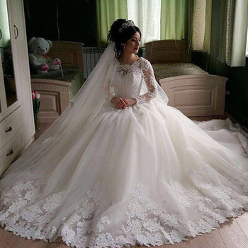 7b30c4da71f5 FA05 Gorgeous Sheer Ball Gown Wedding Dresses 2017 Puffy Lace Beaded  Applique Women's White Long Sleeve