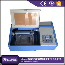 Mini laser stamp engraving machine , co2 mini laser engraver for rubber acrylic paper