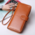 Wholesale Latest fancy trendy PU travel woman magic leather wallet, Fashion faux Leather Lady Purse Card wallet