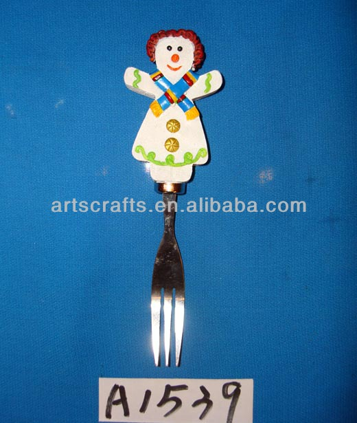 Polyresin snowman handle and stainless steel fork