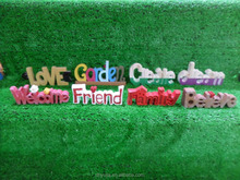 Arts of gypsum words in different colors on lawn for garden decoration