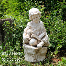 MGO garden sculpture reading little boy statue
