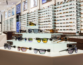 Modern Optical Shop Interior Design With Wooden Sunglasses Display
