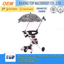 China Newest 5 Wheels Safety Guardrail Baby Stroller for 2-7 Years Old Children