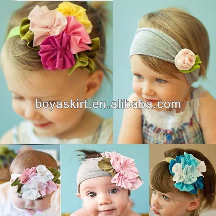 Mädchen Stirnband in Weiß und mit grüner Stoffblume