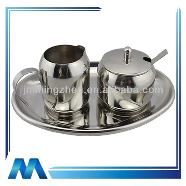 stainless steel milk and sugar set with spoon on tray