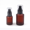 cosmetic bottle packaging 30ml 60ml empty glass lotion bottle 2oz frosted amber glass bottle with black plastic pump