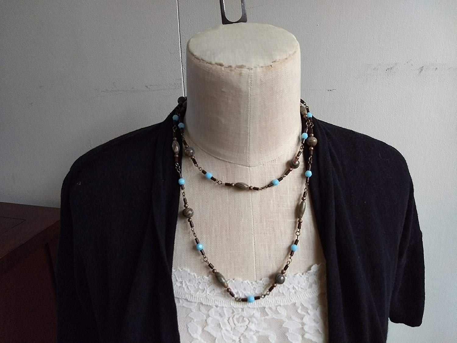 Long boho necklace with blue and bronze colored swirl clay beads, copper wood beads, brown blue wood bead necklace, double strand necklace