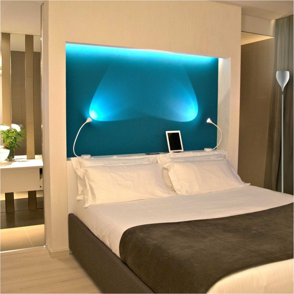 hgtv remodel reading lights lamp headboard bedroom interior wall