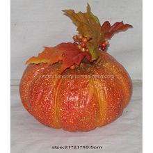 Beautiful artificial plastic orange pumpkin with leaves for Halloween decor