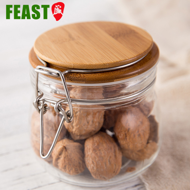 China Factory Custom Cheap Candy Storage Container 4 oz Food Glass Jar Wooden Lid