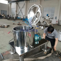 High speed extraction centrifuge with cooling jacket