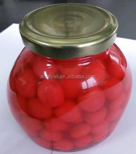 Canned red cherry in glass jar