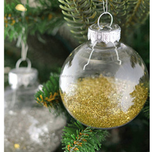 Hanging clear glass baubles ornament on the Christmas tree