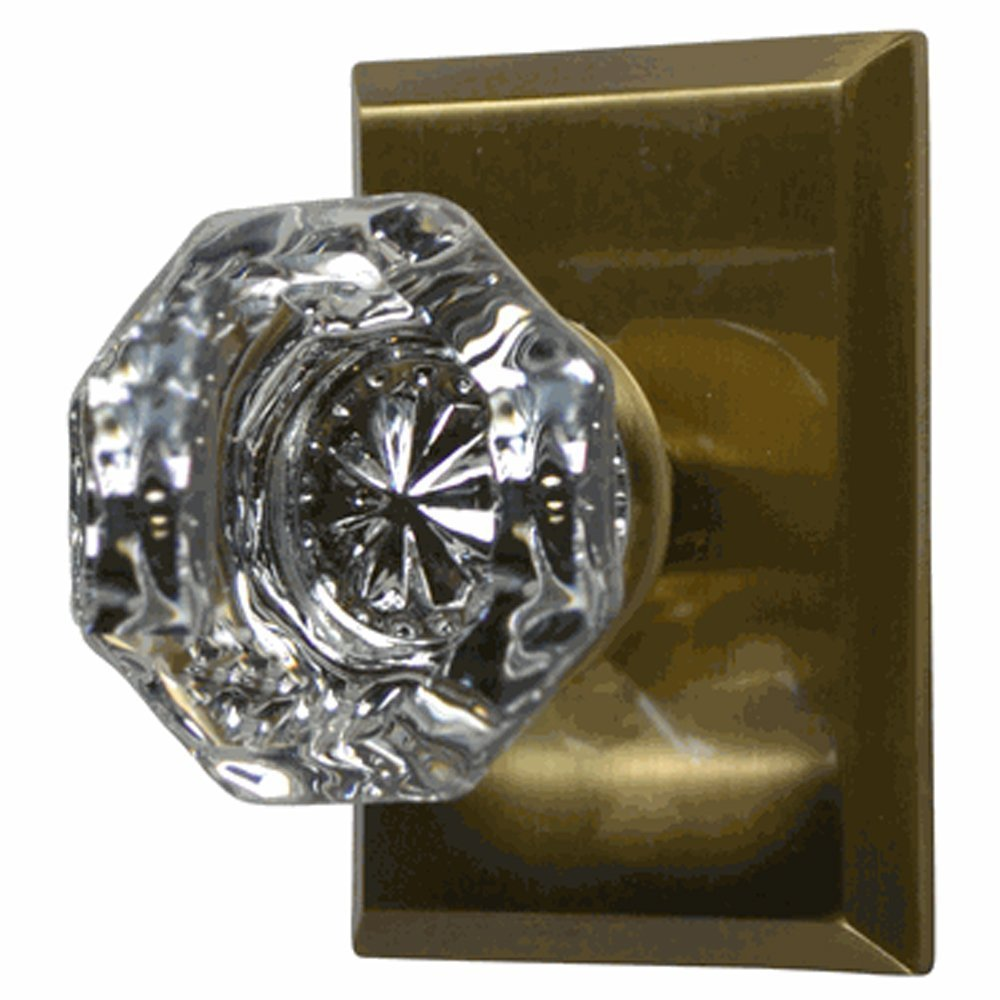 Providence Octagon Crystal Door Knob Set with Square Rosettes in Antique Brass (Privacy Bed/Bath)