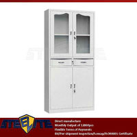 modern office equipment furniture systems glass & metal 4 door lockable cupboard with middle two drawers & adjustable shelves