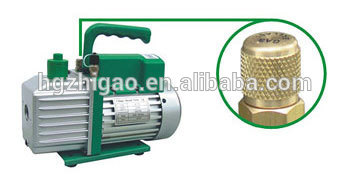 Single stage electric vacuum pump with gauge valve