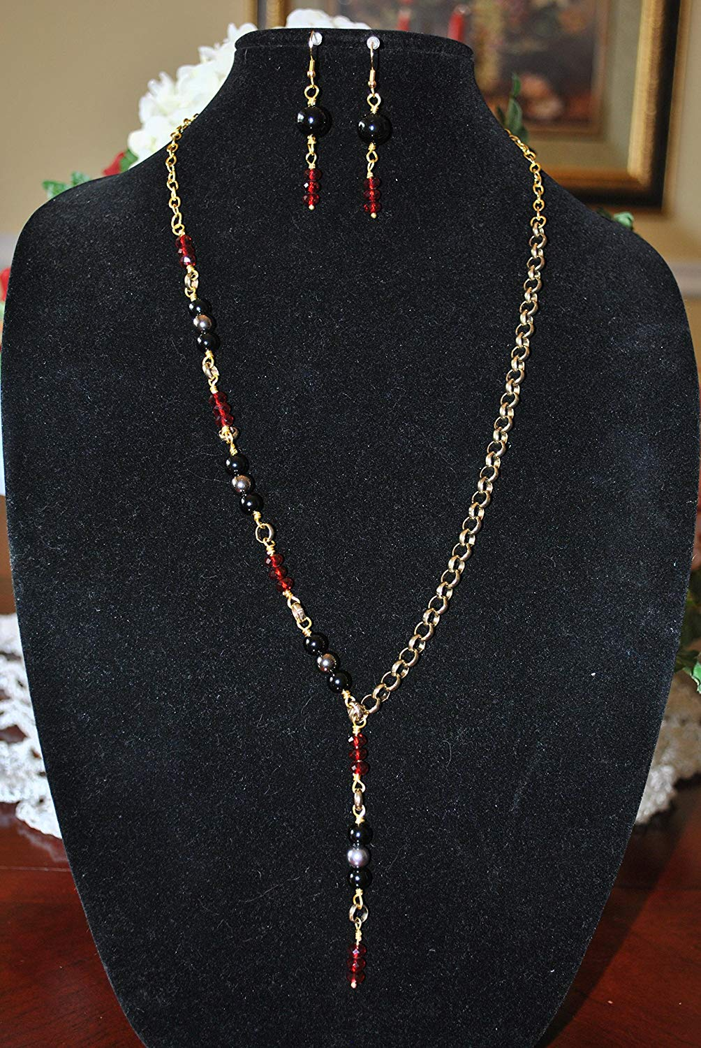 """Beautiful gold-tone necklace with black and red beads with matching earrings. Necklace measures 13 1/2"""" Earrings measure 1 1/2"""""""