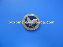 stamped eagle logo metal coin