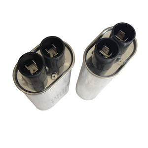 High voltage capacitor for industrial microwave ovens