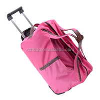rolling duffle bag carry on luggage travel bag in-line skate wheels