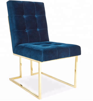 Upholstered blue velvet brass stainless steel legs tufted dining chair