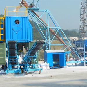 Containerized mobile weighing and bagging unit container unloading system machine