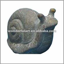 distressed stone snail for garden adornment
