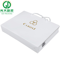 High end gloss white shopping bags for fashion boutiques
