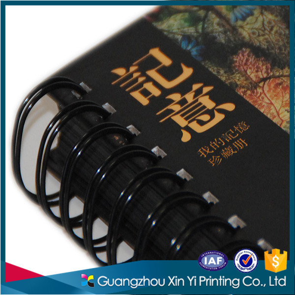 Specail plastic spiral black paper notebook with high quality