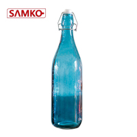 Clear glass water bottle with clip lid for drinking