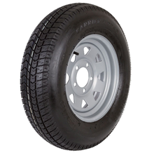 Boat trailer tire mounted on a chrome wheels