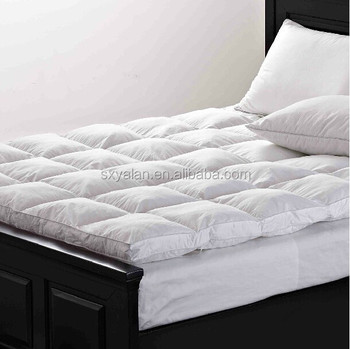 how to clean a feather mattress topper